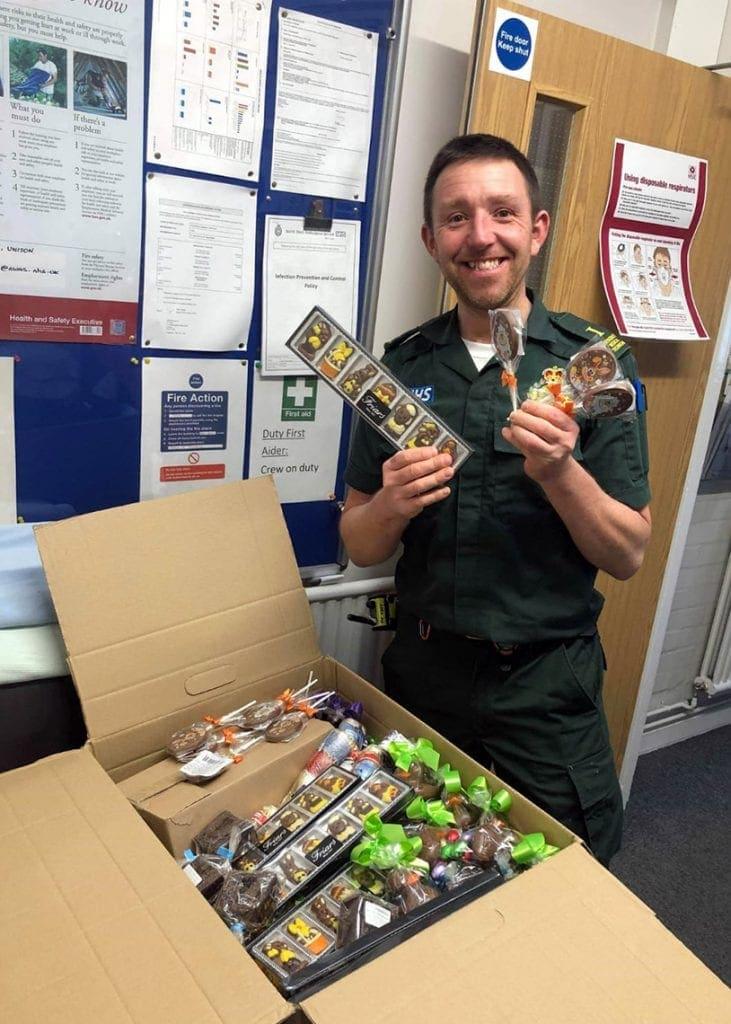 Ambulance technician Dan Jordan receiving the chocolate treats from Ye Olde Friars at the Keswick  station.