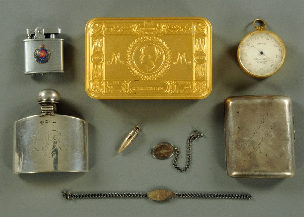 Personal memorabilia including the bullet which injured the colonel, dog tags, lighter and tobacco tin