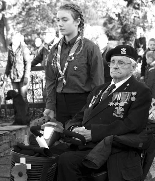 The late World War II veteran Jim Newstead, with Isla Harrison from Keswick Scouts during last year's Remembrance Day