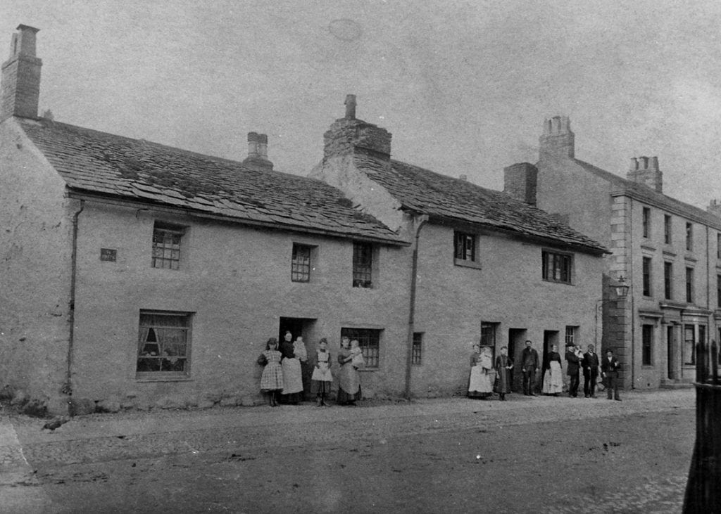 Keswick's Main Street circa 1890s - you can just see the Parish Room railings at the right of the photo.