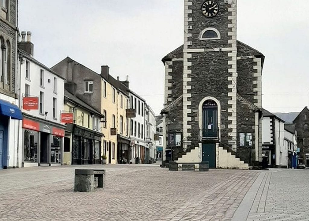 A deserted Keswick Market Square where the majority of shops are still closed