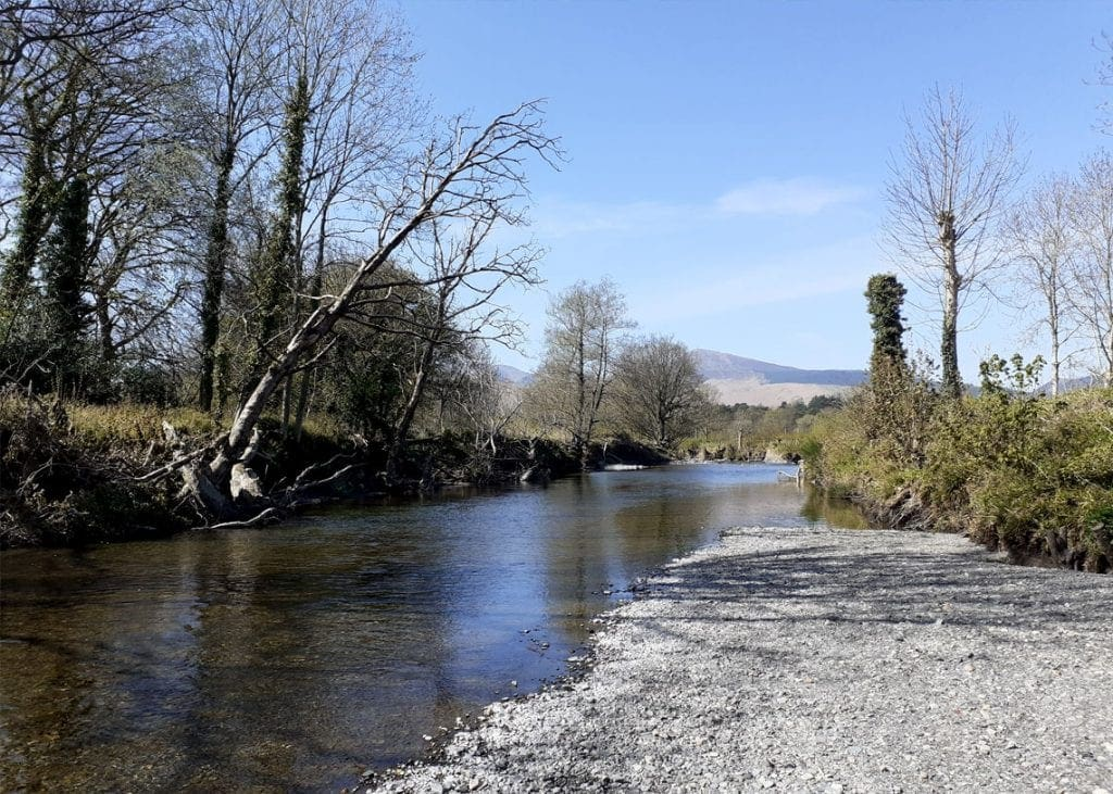 The stretch of gravel bank which almost reaches Keswick Rugby Club field beyond Elliott Park