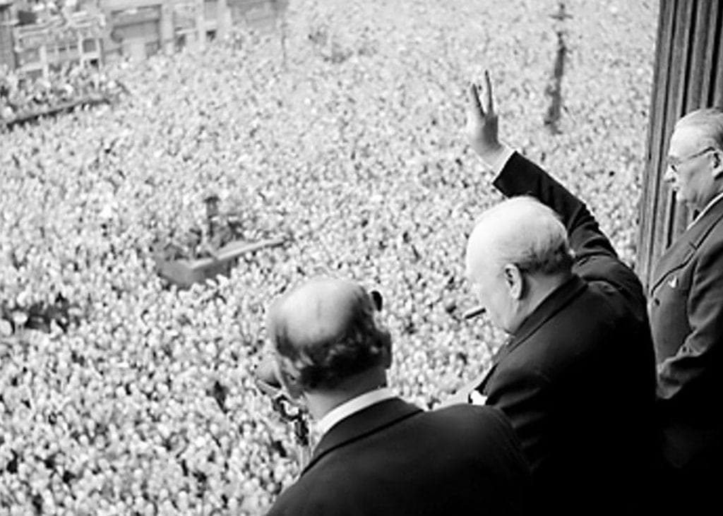 Winston Churchill Waves to Crowd After VE Day, End of War in Europe. Photo by Public Domain.
