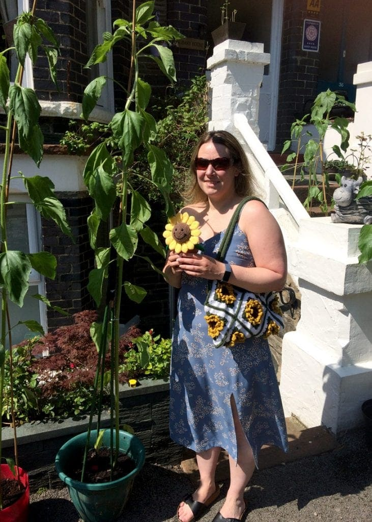 Claire Peat from Keswick with the 6ft sunflower she has grown