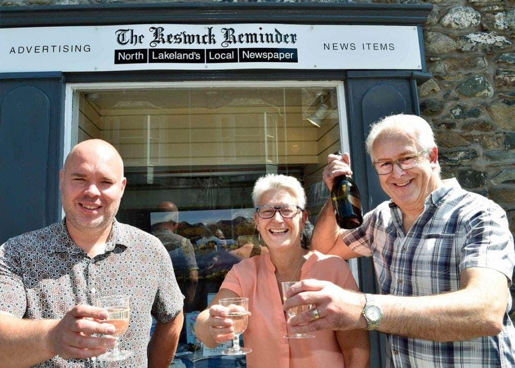 HOLD THE FRONT PAGE Andy Barr (left) toasts the future of the Keswick Reminder with former owners Jane Grave and David Branthwaite.